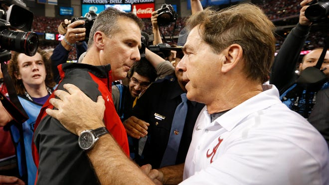Ohio State's Urban Meyer (left) and Alabama's Nick Saban are among the voters in the Amway Coaches Poll this season.
