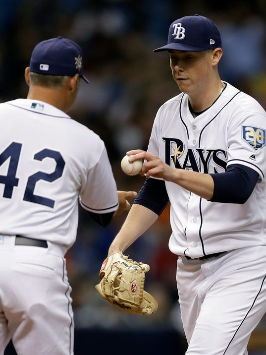 Tampa Bay Rays manager Kevin Cash left, takes pitcher Ryan Yarbrough out of the game against the Philadelphia Phillies during the fourth inning of a baseball game Sunday, April 15, 2018, in St. Petersburg, Fla. (AP Photo/Chris O'Meara)