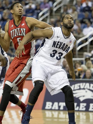 UNLV's Christian Wood, left, and Nevada's Ronnie Stevens Jr. battle for a rebound during a game last season in Reno.