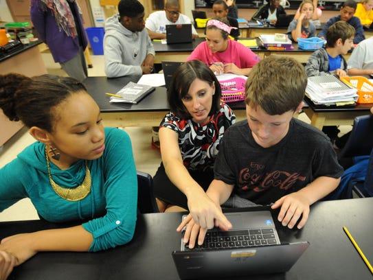 Megan Szabo teaches at F. Nell Postlethwaite Middle