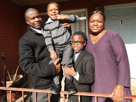 Joseph Genda poses with his wife Francess and their sons Norman, 10, and Patrick, 4, at their home in Salt Lake City on Sunday, Nov. 18, 2018.