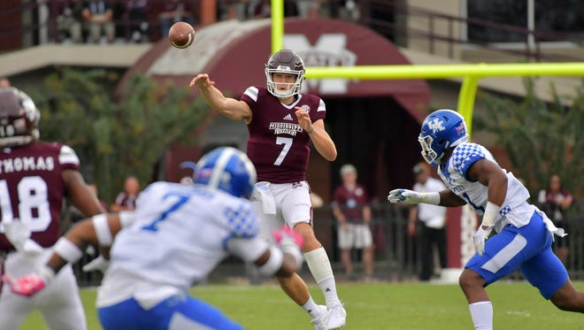Mississippi State Bulldogs quarterback Nick Fitzgerald (7) throws a pass against the Kentucky Wildcats during the first half at Davis Wade Stadium on Saturday, Oct. 21, 2017, in Starkville, Mississippi.