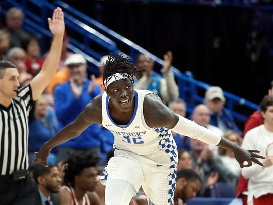 Kentucky's Wenyen Gabriel celebrates after making a