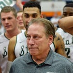 Michigan State coach Tom Izzo (middle) is congratulated after winning his 500th game in a 99-68 win over Boston College at Titan Gym on Thursday.