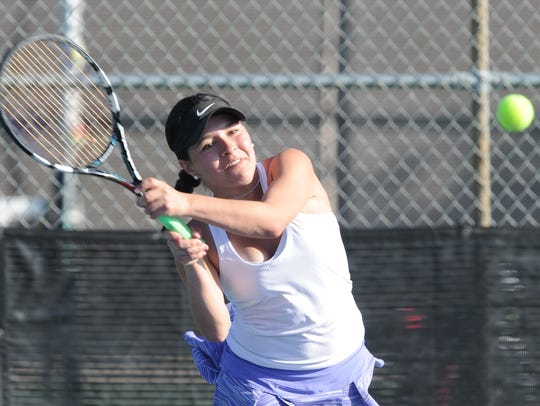 Wylie's Analeah Elias returns a shot in her girls singles