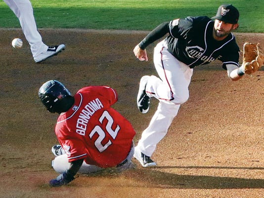 Roger Bernadina of the Albuquerque Isotopes slides safely into second base as El Paso Chihuahuas second baseman Casey McElroy reaches to catch the throw Sunday night at Southwest University Park.