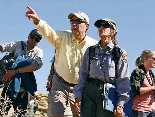 New Mexico Sen. Tom Udall, left, and Dabney Ford, chief of cultural resources at Chaco Culture National Historical Park, discuss features of the park on Monday during a hike.