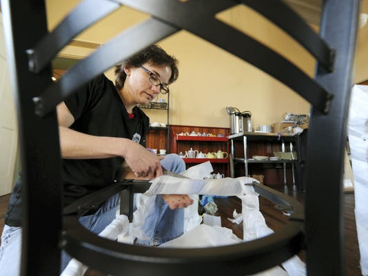 Dani Sanders, owner of Red Brick Bakery & Tea Room in Red Lion, unwraps new chairs for her shop's expansion. The bakery and tea room has expanded into the adjoining space next door making it now triple its original size.