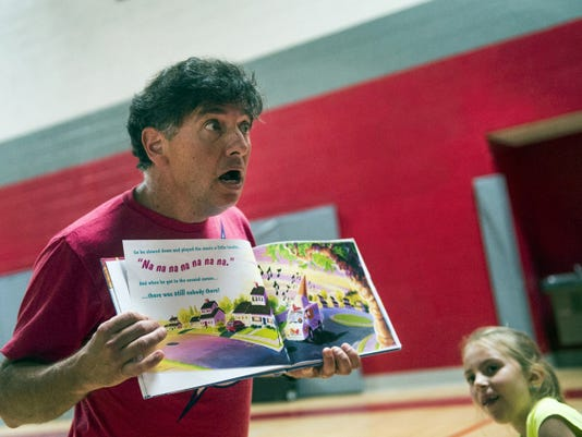 Joe Consiglio, known as Silly Joe, reads a story to the audience during a performance at Bermudian Springs Elementary.