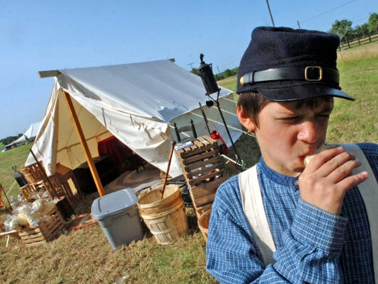 Re-enactor Tyler Martin, 13, tries some hard tack during a Civil War battle re-enactment in 2006.