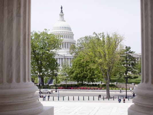 The Capitol building is seen through the columns on the steps of the Supreme Court on May 5, 2014 in Washington.