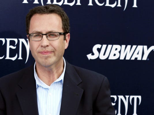 """FILE - In this May 28, 2014, file photo, Subway restaurant spokesman Jared Fogle arrives at the world premiere of """"Maleficent"""" at the El Capitan Theatre in Los Angeles. A new court document filed Wednesday, Aug. 19, 2015, by the U.S. Attorney's Office charges the longtime Subway pitchman with engaging in sex with minors and receiving child pornography. (Photo by Matt Sayles/Invision/AP, File)"""