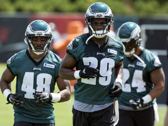 Eagles running back DeMarco Murray (29) heads over to the next drill as Raheem Mostert, left, and Ryan Mathews follow during practice in Philadelphia. DeMarco Murray traded in the blue star on his helmet for silver Eagles wings, swinging the power in the NFC East from Dallas to Philadelphia.