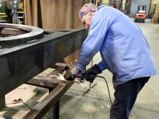 Sparks fly as Roger Weaver performs some grinding at Kercher Industries in North Lebanon Township recently. Owner Ed Kercher says there is a shortage of skilled laborers right now, though his company has been fortunate in finding the people needed to fill positions.