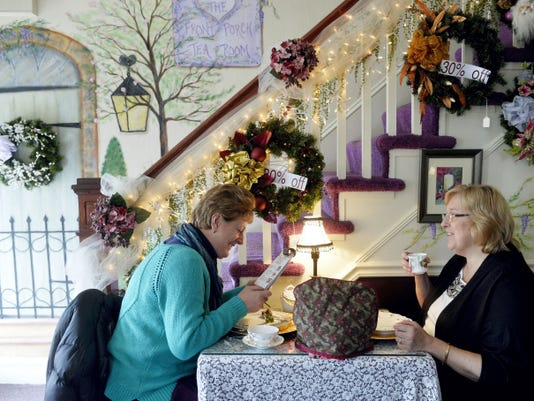 From left, Fran Northup-Gallagher of New Oxford and her sister-in-law Sue Gallagher of Bel Air, Md., share high tea at the Front Porch Tea Room on a Saturday in January. The tea room has been open since 2000.