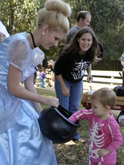Cinderella, far left, played by Kaitlin Cramer, treats Olive Daly as Olive's mom, Toni Daly, watched in 2013.