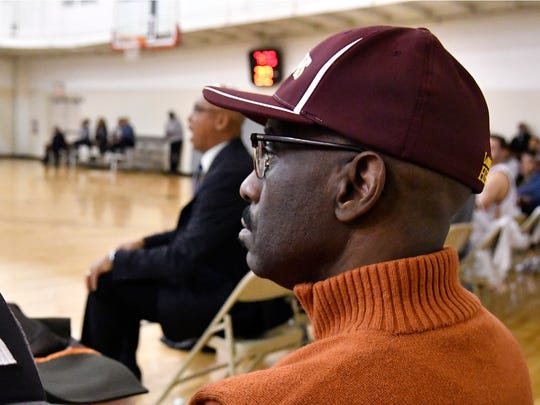 Simmons College President Dr. Kevin Cosby, right, watches the action during as head coach Jerry Eaves shouts instructions to his team during action against Hiwassee College, Monday, Dec. 05, 2016 in Louisville KY. (Timothy D. Easley/Special to the C-J)