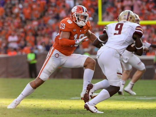 Clemson safety Tanner Muse(19) chases Boston College wide receiver Kobay White (9) during the third quarter in Memorial Stadium at Clemson on Saturday.