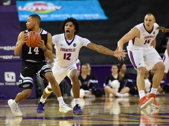 University of Evansville's Dru Smith (12) creates a double-dribble turnover as the University's of Evansville Purple Aces play the Missouri State Bears at the Ford Center Wednesday, January 10, 2018.