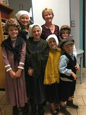 Janie Niedfeldt with her grandchildren as town and immigrant children.