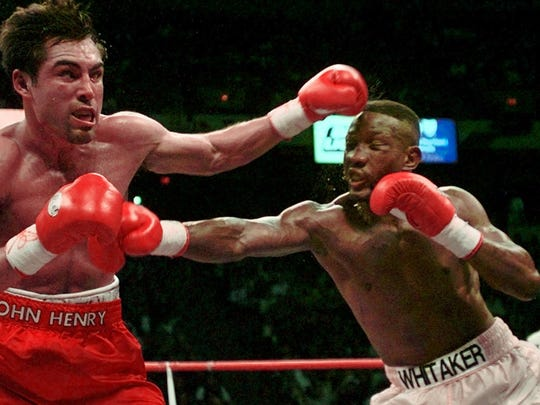 Pernell Whitaker, right, and Oscar De La Hoya exchange punches during their WBC Welterweight Championship fight at Thomas & Mack Center in Las Vegas, in 1997. De La Hoya won. (AP Photo/Bob Galbraith)