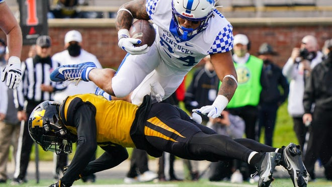 Oct 24, 2020; Columbia, Missouri, USA; Kentucky Wildcats running back Chris Rodriguez Jr. (24) leaps over Missouri Tigers safety Martez Manuel (3) during the first half at Faurot Field at Memorial Stadium. Mandatory Credit: Jay Biggerstaff-USA TODAY Sports
