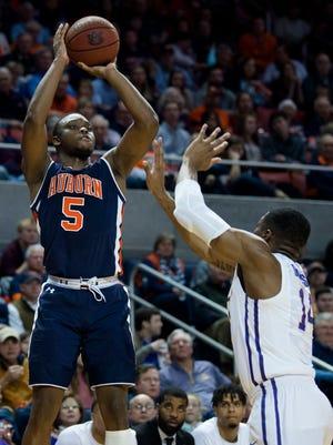 Auburn guard Mustapha Heron (5) hits a 3-pointer over LSU guard Randy Onwuasor (14) during the first half of an NCAA college basketball game Saturday, Jan. 27, 2018, in Auburn, Ala.