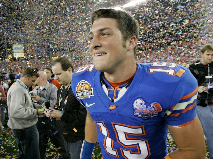 FILE - In this Jan. 8, 2007, file photo, Florida quarterback Tim Tebow celebrates his team's 41-14 victory over Ohio State at the BCS national championship football game in Glendale, Ariz. No. 22 Florida is honoring their most famous quarterback again. The Gators will induct Tebow into the program's Ring of Honor at halftime of Saturday's game against fifth-ranked LSU. (AP Photo/Matt York, File)