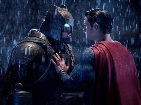 "Ben Affleck as Batman, left, and Henry Cavill as Superman in a scene from, ""Batman V. Superman: Dawn Of Justice."""