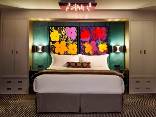 "This undated image provided by Loews Hotels shows the Pop Art Suite at Loews Regency New York in Manhattan. Loews launched a campaign of short how-to videos called ""Loews Knows"" to share tips from the hotel's expert staff on decorating, cleaning, entertaining and more."