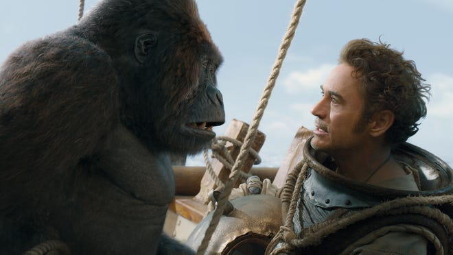 Dolittle (Robert Downey Jr.) has a discussion with Chee-Chee (voice of Rami Malek).
