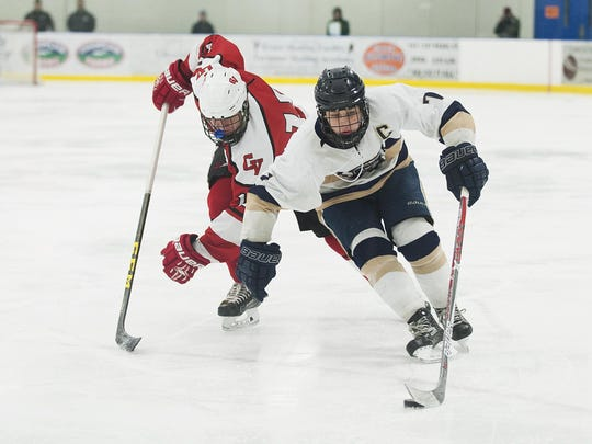 Essex's Ryan Young (7) skates with the puck during the boys hockey game between the Champlain Valley Union Redhawks and the Essex Hornets at the Essex Skating Facility.