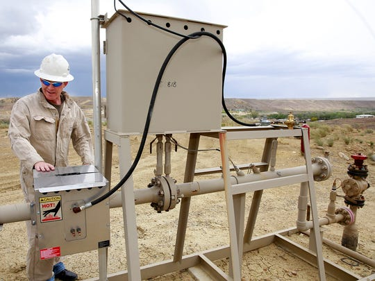 Tom Mullins, owner/operator of Synergy Operating LLC, at one of the company's gas wells on May 17 near La Plata Highway and Twin Peaks Boulevard. With slumping commodities prices, more wells like this are being shutin, so state and federal agencies are looking at ways to prevent low-producing wells from being permanently abandoned.