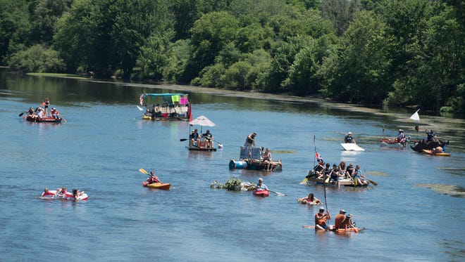 Homemade rafts and kayaks start their float at the Battle Creek Metropolitan Area Moustache Society's Up the Creek Raft Regatta on the Kalamazoo River on Saturday.