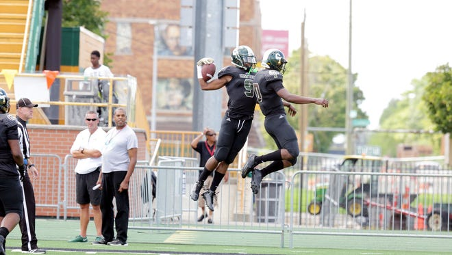The state's top recruit Donovan Peoples-Jones (9), left, celebrates after scoring a touchdown with his teammate during the first half. He lead Cass Tech to a 45-27 win over Oak Park during the Detroit Prep KickOff Classic Sunday, Aug. 28, 2016 at Wayne State University's Tom Adams football field.Regina H. Boone/Detroit Free Press