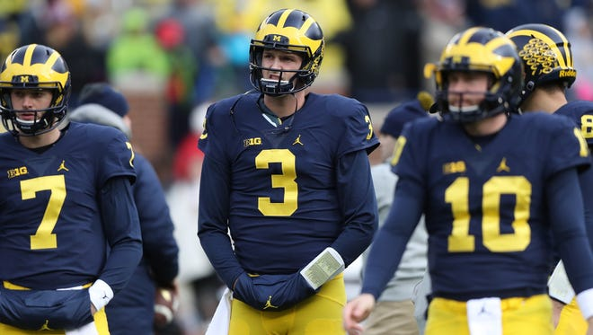 University of Michigan Wolverine's Wilton Speight watches warm ups before action against the Indiana Hoosiers Saturday, November 19, 2016 at Michigan Stadium in Ann Arbor MI.  Kirthmon F. Dozier/Detroit Free Press