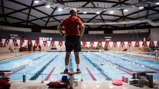 Ball State men's swimming coach Bob Thomas watches his team warm up at Lewellen Pool.