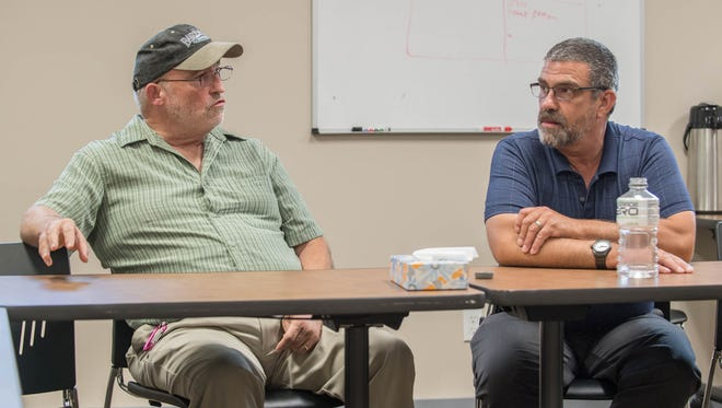 Summit Pointe recovery coaches David White left, and Mark Monroe talk about the opiate epidemic in Calhoun County during a recent interview with the Battle Creek Enquirer.