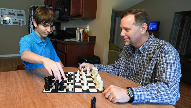 James Campbell plays chess with his sone Jonathan, 13, at their home in Pelzer Wednesday, June 13, 2018.