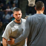 Memphis Grizzlies forward Chandler Parsons exchanges a greeting with teammate Marc Gasol prior to the game against the Philadelphia 76ers at FedExForum.