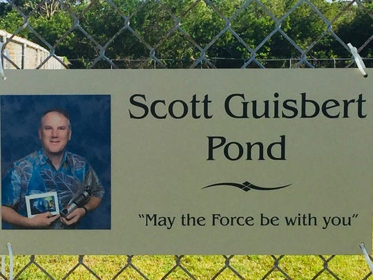 The pond at Jefferson Middle School has been named in honor of science teacher Scott Guisbert, who, after 27 years at the school, is being forced to retire by pancreatic cancer.