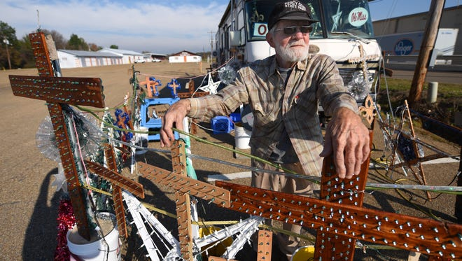 John Baker of Bogue Chitto hand-makes the crosses, stars and other decorative items — most featuring twinkling lights — that he sells during the holidays outside his RV at the Jones Center Flea Market in Pearl.