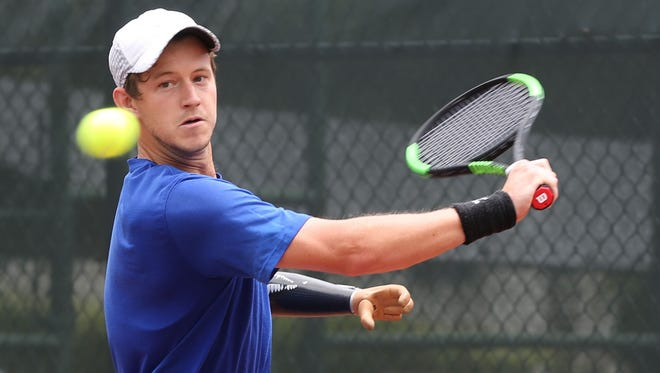 New Zealand's Alex Hunt prepares for a backhand return to Northern Mariana Islands' Christopher Cajigan in an opening day match of the 2017 King's Guam Futures, an ITF Pro Circuit event presented by Docomo Pacific and Hilton Guam Resort & Spa. Hunt won 6-0, 6-0.