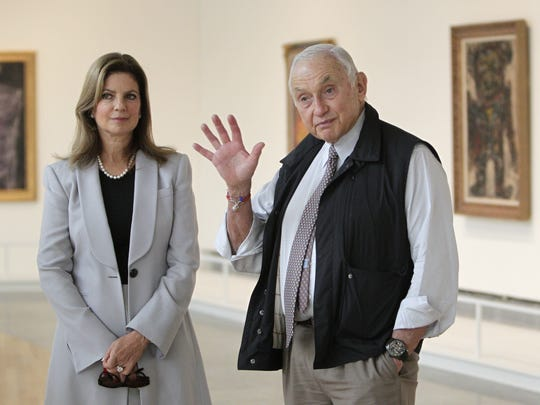 L Brands CEO Les Wexner, right, was financier Jeffrey Epstein's most prominent client. Wexner is pictured with his wife, Abigail, in 2014.