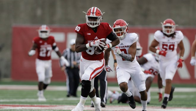 Indiana tight end Ian Thomas (80) runs for a touchdown during the first half of an NCAA college football game against Rutgers, Saturday, Nov. 18, 2017, in Bloomington, Ind.