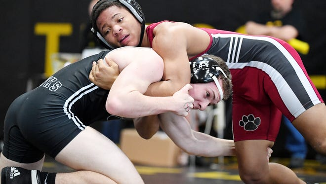 North Buncombe's Hayden Dehart, left, and Asheville's Deonte Whitson, right wrestle in the WMAC tournament at Tuscola High School January 27, 2018.