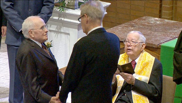 George Harris, left, and Jack Evans took commitment vows Saturday, March 1, 2014, in Dallas. The ceremony was performed by the Rev. Bill McElvaney, a retired Methodist pastor who risked losing his pension and credentials to perform the service. The Methodist church does not condone gay marriage.