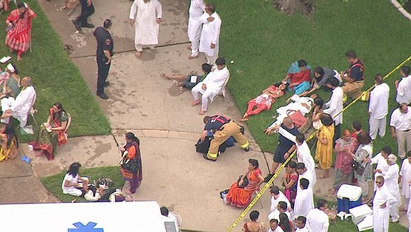 The injured are treated outside of an apartment floor collapse west of Houston on Thursday, June 26, 2014. The collapse occurred as people were gathered for a religious celebration.