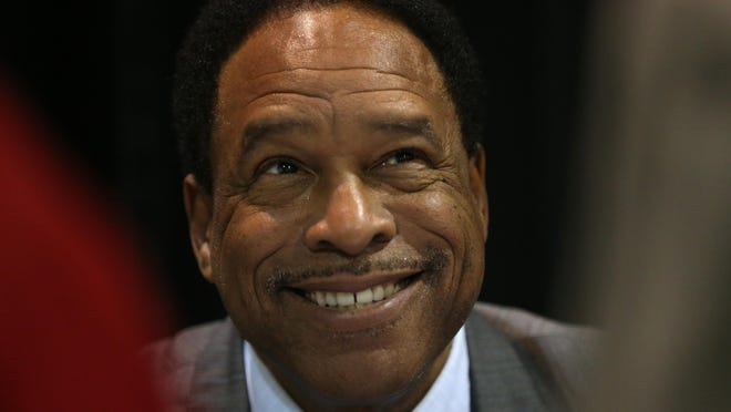 Dave Winfield shares a laugh with people who waited in line for an autograph before the annual Compeer Rochester luncheon.