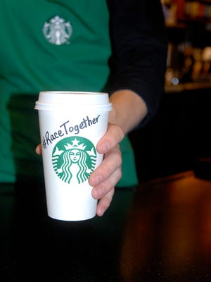 Starbucks baristas have started writing the words Race Together on cups to start a conversation with customers about race relations in America. (Starbucks) ORG XMIT: GANNETT [Via MerlinFTP Drop]